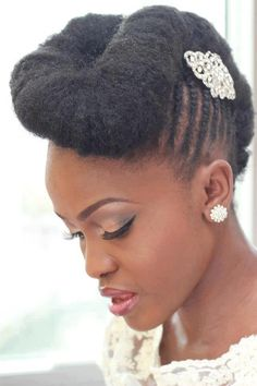 Natural bride with hair in cornrows and chignon style. Similar to Janelle Monae's hair.