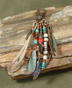 So many uses for this tassel charm. Clip it on your purse, jeans belt loop, zipper, backpack or add to your key chain....anything you can clip