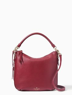 a soft-bodied little sack with a lot of style, our small ella is the perfect go-anywhere bag. constructed in luxurious pebbled cowhide, it features a secure zip-top closure and can be carried either over your shoulder or cross-body, with the addition of an adjustable matching strap.