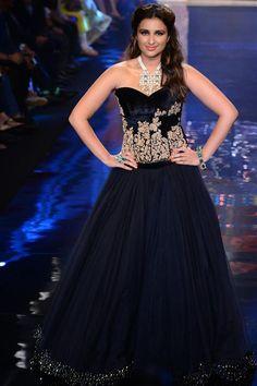 Strikingly beautiful black piece consists of handem bellished corset and flouncy sheer skirt.