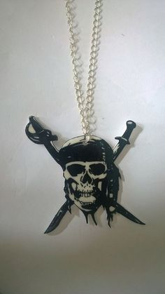 Hand drawn skull and swords shrink plastic necklace. by BeUniqueCrafting on Etsy