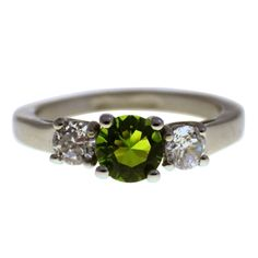 Made from hypoallergenic surgical stainless steel. This August birthstone ring is adorned by three beautiful CZ (cubic zirconia) stones. The center stone is a stunning 6mm light green, Peridot in color, CZ stone. There are two 4mm clear side mounted CZ stones. The simulated Peridot and diamond CZ stones sparkle in the light just like the real gemstones. This August birthstone ring has a 2.5 mm wide high polished band, available in rings size 5, 6, 7, 8, 9 or 10.