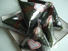 Samgak Kimbap - Korean rice triangles in edible seaweed.  Use steamed or fried rice and just about any filling you can think of that goes well with it. Wrapper has plastic sheet between rice and seaweed so it stays crisp.