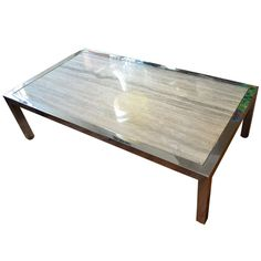 Monumental Travertine and Chrome Coffee Table | From a unique collection of antique and modern coffee and cocktail tables at http://www.1stdibs.com/furniture/tables/coffee-tables-cocktail-tables/