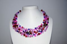 Statement necklace (handmade) with glass beads and multiple versions of jade and Agatha stones. For sale.