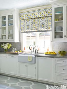 In a Charlotte, North Carolina house, designer Lindsey Coral Harper made a Roman shade in the same fabric as the kitchen sofa, Thom Filicia's Prospect in Shadow for Kravet, to carry the ikat pattern across the room.   - HouseBeautiful.com