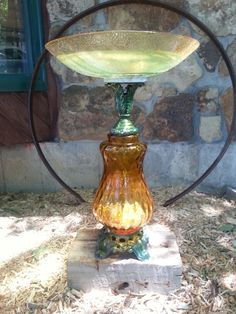 Homemade bird bath out old lamp and salad bowl
