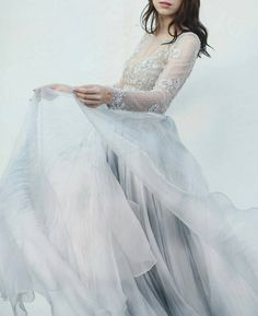 Beautiful winter wedding gown with lace long sleeves and chiffon skirt with a blue tint.