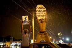 News Article: Mike Brown Shooting: The Most Powerful Ferguson Protest Signs Ferguson Protest, Ferguson Missouri, Assata Shakur, Ronnie Spector, Gil Scott Heron, Betty Davis, Ike And Tina Turner, Michael Brown, Protest Signs