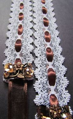 Lace Wedding Dress Sash - white lace sash with brown ribbon, brown rhinestones and crystal brooches. It is finished on the ends with brown ribbon which ties into a bow for a perfect fit.