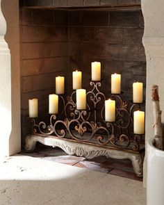 Fireplace with candles. Looking for something to do when an actual fire isn't appropriate.   Orante Fireplace Candelabra.