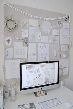 This home office is just too nice. I love the white collage!