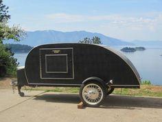 Matte black trailer wrap with gloss lettering trailer for Evergrain com