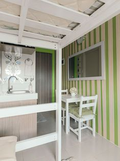 This unit proves that it's possible to live comfortably in a tiny space Condo Interior Design, Condo Design, Interior And Exterior, Small Condo Living, House Tours, The Unit, Kitchen, Room, Furniture