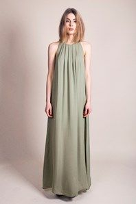 Daylight is a wonderful full-length dress from Swedish brand Stylein in beautiful olive silk georgette. The expressive width of fabric gives a beautiful flow. The pleated details front in combination with the high cut neckline brings a tailored touch to the loose fitted and sleeveless dress. Slightly transparent, with matching lining and concealed zip at the drop-shaped detail in the back. Removable waistband.