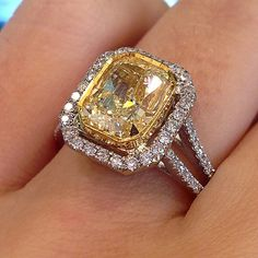 Would you say yes to this fancy yellow radiant cut halo style engagement ring? #fancyyellow #radiant #diamond #engagementring #diamonds #jewelry #love #pretty #sparkle #ring #inlove #proposal...