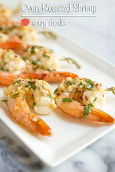 Oven roasted garlic cilantro lime shrimp baked on a sheet pan is a really simple and healthy recipe that takes less than 20 minutes from start to finish. Not only is it easy, it delivers on flavor! Lime Shrimp Recipes, Cilantro Lime Shrimp, Seafood Recipes, Seafood Meals, Roasting Garlic In Oven, Oven Roast, Shrimp Appetizers, Appetizer Recipes, Dinner Recipes