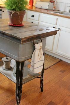 Upcycled Washtub into Kitchen Island. Lift off top for more storage at Magazine Your Home: 1920's Home Tour