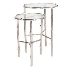 Nobu Nesting Table Set. Our Nobu Nesting Table Set will appeal to the eclectic in you. Featuring a round glass top supported by a base of cast tree branches, finished in silver. Sold as a set of two, these unique side tables will add a touch of whimsy to any room.