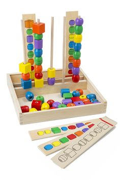 Bead Sequencing Set Classic Toy : Stack the brightly colored beads on five hardwood dowels to match the pattern cards! Includes more than 45 brightly colored wooden beads and 5 double-sided wooden pattern cards. A sturdy wooden storage box contains all the pieces and holds the dowels upright for playtime. The 10 patterns increase in difficulty to build matching, sequencing, and fine motor skills.