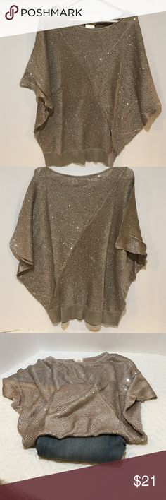 Shimmery Blush Matty M poncho sweater Shimmery Blush Matty M poncho sweater, comes with storage bag as well.  This is great for a casual or dressy night out. The bag has not been opened. It is still zip tied shut. DRY CLEAN ONLY! Please ask questions. I also have other colors, Dark Gray, Ash Green, Pearl and Black. Matty M Sweaters Crew & Scoop Necks