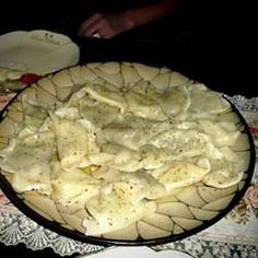 These potato- and porcini mushroom-stuffed Ukrainian dumplings are like large ravioli. Serve them with butter and fresh herbs, fried onions, or sour cream with dill.