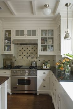 kitchen:white cabinets, beige countertop, grey/green paint, white