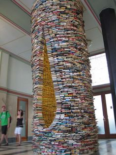 """This """"tower of books"""" sculpture entitled Idiom by Slovakia-born Matej Kren, can be seen at the Prague Municipal Library, in Prague."""