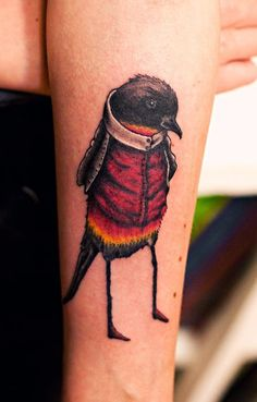 Odd and interesting tattoo of an anthropomorphised bird