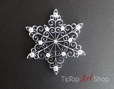 This beautiful quilled snowflake ornament can be a perfect Christmas present or a favor for your winter wedding. You could hang it on your tree as a part of your home decoration for the holidays, but why not use it during the whole winter! Its 100% handmade in quilling technique and its gift packaged.The size is 8.5cm (~3.3) in diameter. The ornament is made from 4mm (~0.16) white paper strips with very delicate golden shine and is decorated with rhinestones. It comes whit a thread and is…