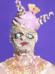 English artist James Ostrer has created a series of creepy portraits of people covered in fast food: cream, sweets, burgers, etc.
