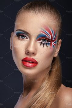 Woman with British flag on face by Yevgen Romanenko on @creativemarket