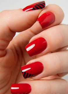 Bright red nails and simple black details. Simple but chic and classy!