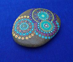 Large painted mandala stone hand painted by BenDyerOriginalArt