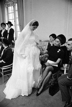 Sophia Loren admiring a wedding gown at a Christian Dior fashion in Paris, 1968
