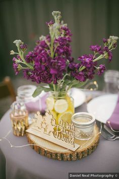Rustic wedding centerpiece idea - purple and yellow wedding centerpiece - See more from this laid-back day on WeddingWire! {Daniel Neal Photography}