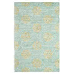 Stylishly anchor your dining set or living room seating group with this hand-tufted wool rug, showcasing a lovely damask-inspired medallion motif in turquois...