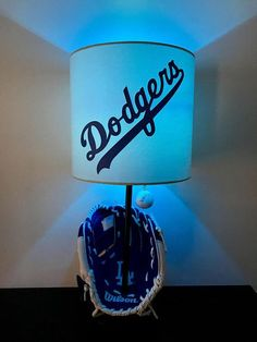 This is a Los Angeles Dodgers baseball table lamp and it is approximately 19 inches tall. The shade is approximately 8 wide. You will get a blue colored bulb with your lamp purchase. This makes a great addition to any man cave, sports bar or kids room for a night light