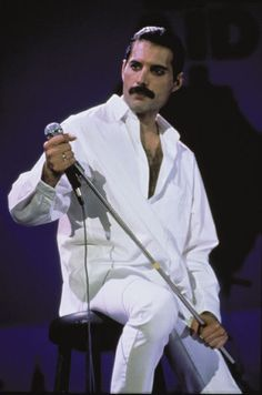 "Freddie Mercury: The sleeve photo from the George Michael + Queen EP. One of my all time favorite photos of Freddie. It's from Live Aid when Brian and Freddie came out later on and performed ""Is This The World We Created?"""