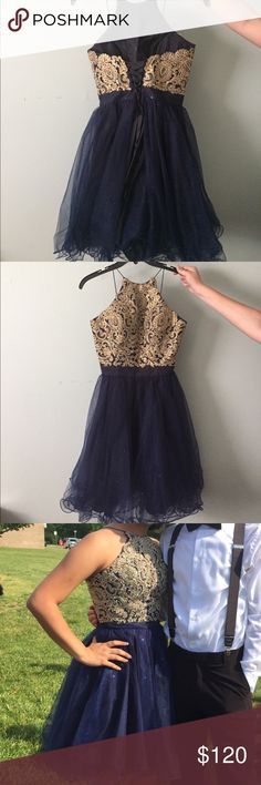 dress Navy blue with gold detail and gold rhinestones at top. Band around the waist. Halter style dress. Thin straps non adjustable. Bottom part sparkly. Corset back with ribbon. Only worn once Damas by Tiffany and Design Dresses Prom