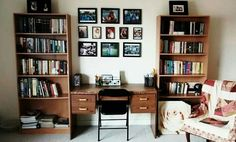 Living room/library. Snail mail station and reading chair. Fireplace.