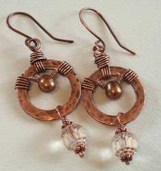 copper washer earrings 002 by Lune2009, via Flickr Seems like these would be a little on the heavy side, for earrings...but I love the different gauges of wire in the wraps, and it would be a great use for all of those copper washers I keep finding at work...pendant, perhaps?
