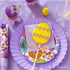 Make place-settings special by finishing with Easter-egg cookie pops over pretty pastel tableware, layered with hints of a floral print.