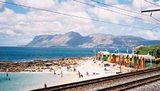 One of my favourite beaches to just hang out with the kids: St James tidal pool. Beautiful scenery, trains going by every so often, and a nice, sheltered place to paddle! James Beach, South African News, Saint James, City Art, Cape Town, Sunday School, Growing Up, Dolores Park, Surfing