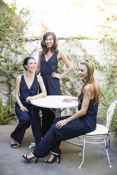20 Wedding Parties That Prove Bridesmaids' Jumpsuits Are Just as Beautiful as Dresses women sitting at round table wearing bridesmaids jumpsuits Chic Bridesmaid Dresses, Casual Bridesmaid, Navy Bridesmaids, Bridesmaid Jumpsuits, Wedding Dresses, Red Bouquet Wedding, Red Wedding, Boho Wedding, Wedding Attire