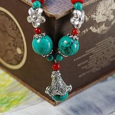 YN-451 Ethnic Tibetan silver jewelry handmade turquoise necklace fashion essential natural morning glory morning glory turquoise necklace  Material: Tibetan silver, turquoise, coral, beads  Specifications: Morning Glory total length 2cm, the maximum bead diameter of about 1.5 cm, total length of necklace 30cm