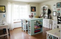 This is so the dream craft room!  I absolutely adore the large windows and the island craft station with the pop of colour.  I would be so inspired here.