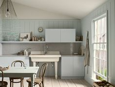 Repaint existing cabinets to give them a fresh look. Image Via: Kohler