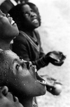 School children in rain storm. Lesotho. 1981. Sebastião Salgado photo