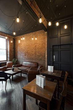 Exposed brick restaurant interior with black walls and ceilings Brick Restaurant, Deco Restaurant, Restaurant Design, Restaurant Lighting, Restaurant Seating, Pub Design, Coffee Shop Design, Coffee Shop Interior Design, Design Hotel